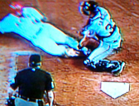 DCP02602.JPG: Santiago blocks Anderson and tags him out at the plate for two outs in the bottom of the third. Molina would be forced out at first to end the inning.