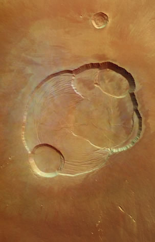 Olympus Mons caldera: The caldera at the summit of Olympus Mons on Mars, photographed by Mars Express. Olympus Mons has an elevation of 24 km relative to the surrounding surface (three times Mt Everest) and the caldera has a depth of about 3 km